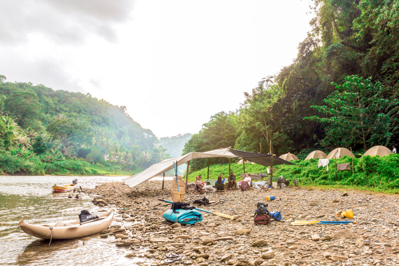 A basic camp set up along the banks of a river