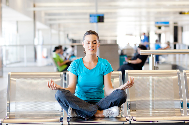 A woman meditating in the airport