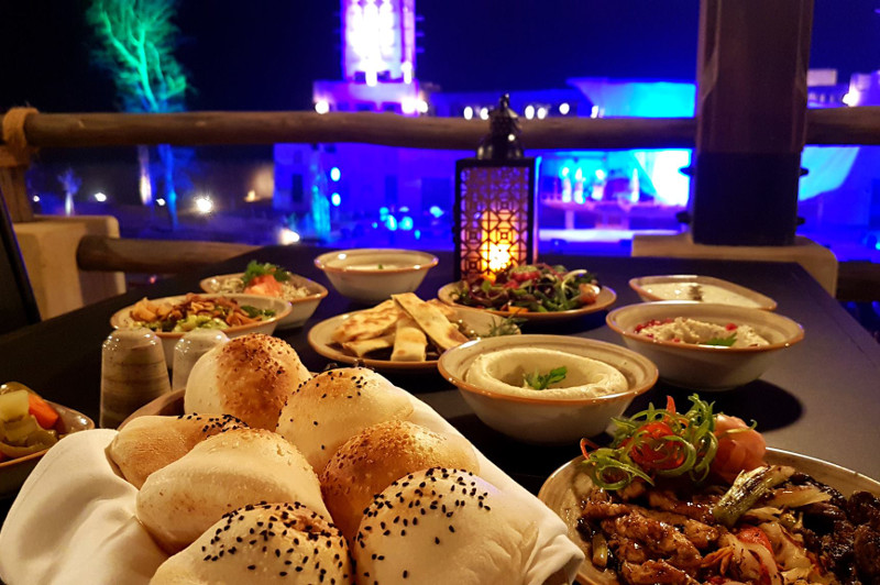 Food at restaurant with show in background