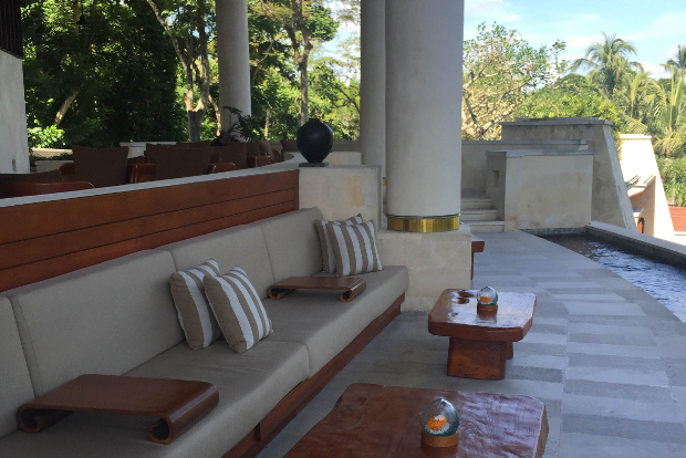 Interior view of the living area of the room looking out over the balcony and private pool