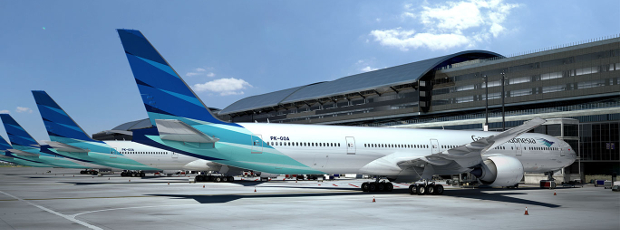 Some Garuda Indonesia planes lined up at the gates