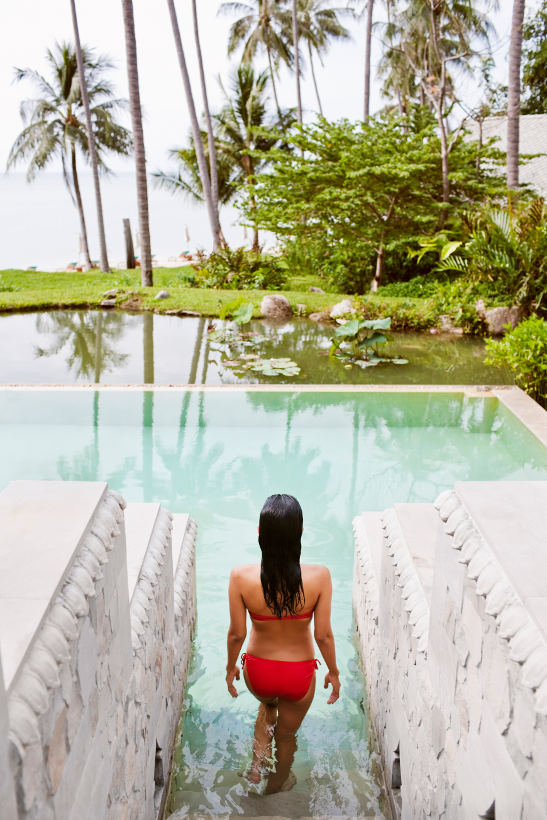 woman walking into pool samui thailand