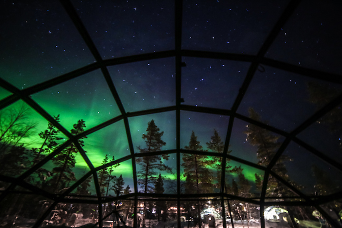 The breathtaking splendour of the aurora borealis seen from a glass Igloos, Saariselka, Finland - 14 Romantic travel experiences for valentines day