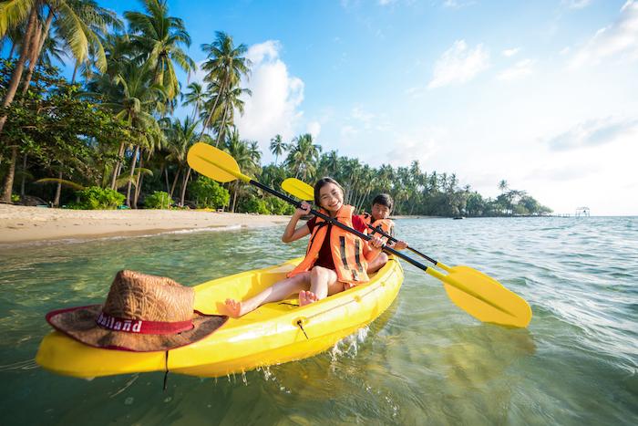 kids having fun kayaking in Thailand