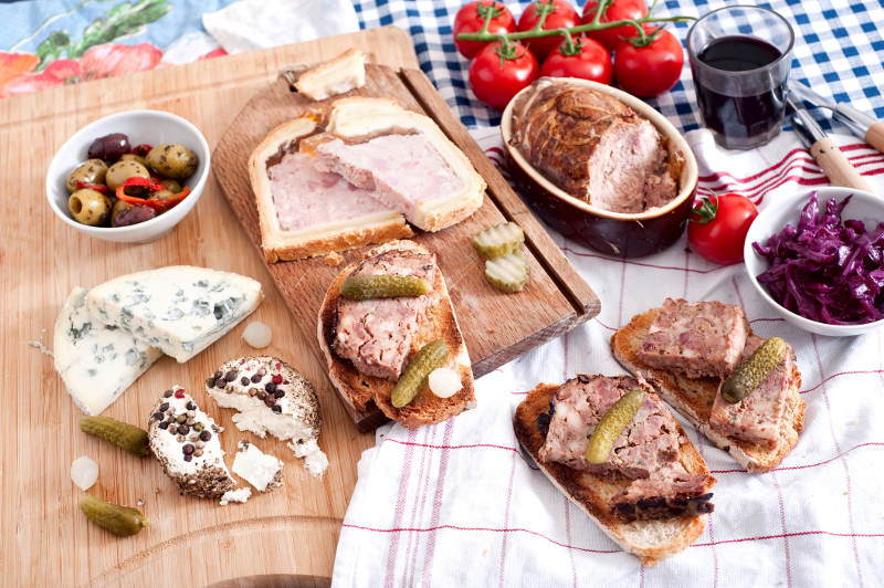 french food on table from above, pate, terrine, bread