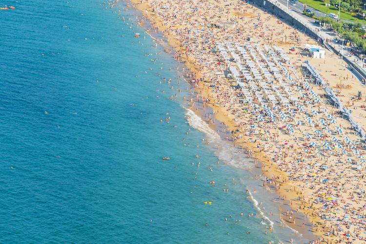 Busy beach in San Sebastian, Spain
