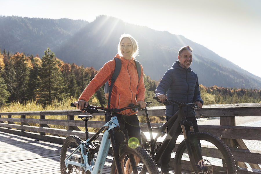how to avoid getting sick while travelling - couple mountain biking