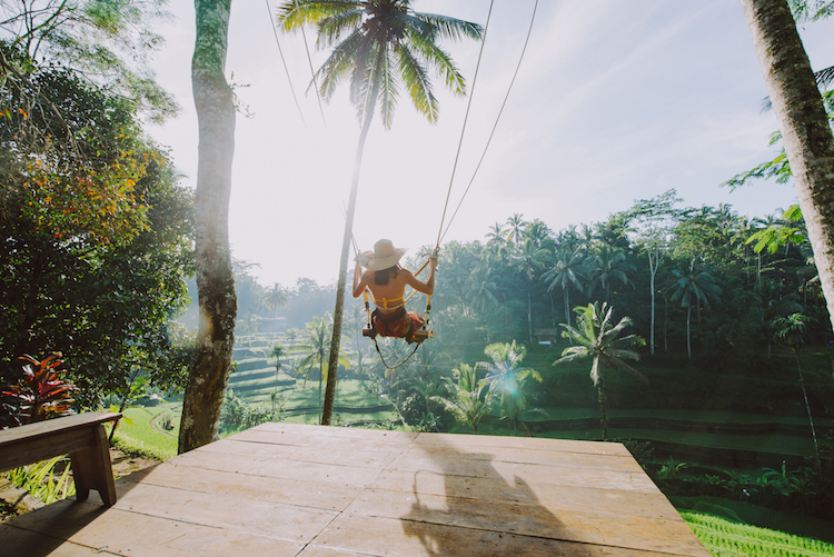 girl on swing in ubud