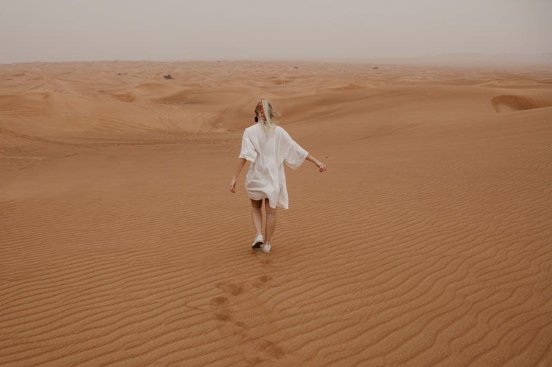 Woman running in desert in Dubai