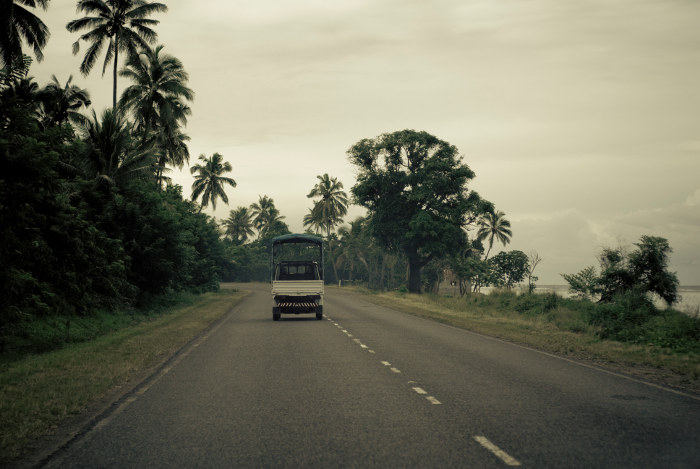 Small truck driving along road in Fiji
