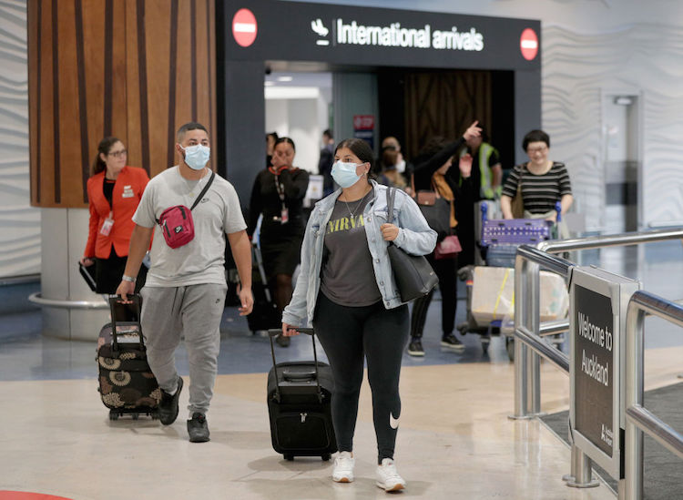 international travellers arriving home