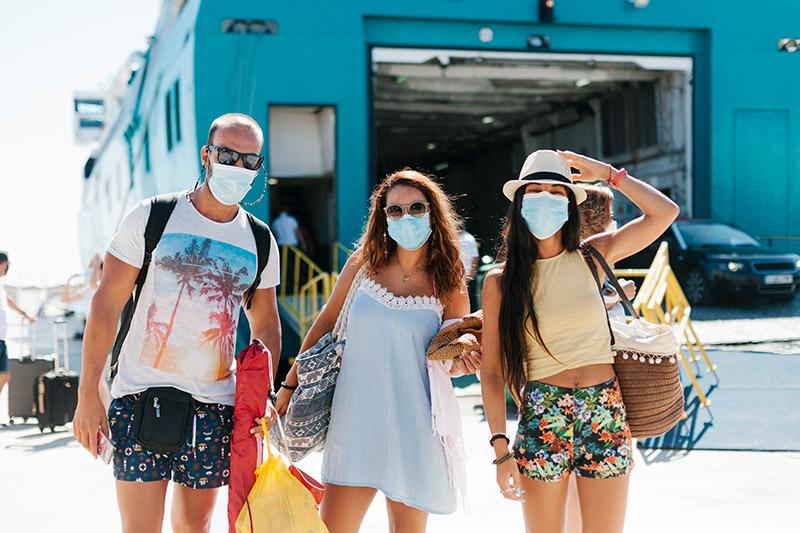 Friends wearing masks