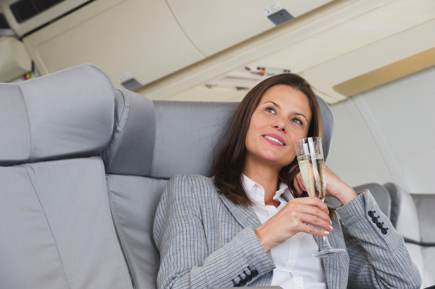 Woman drinks champagne on flight