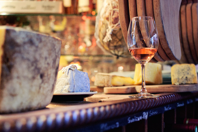 wine and cheese in french cafe