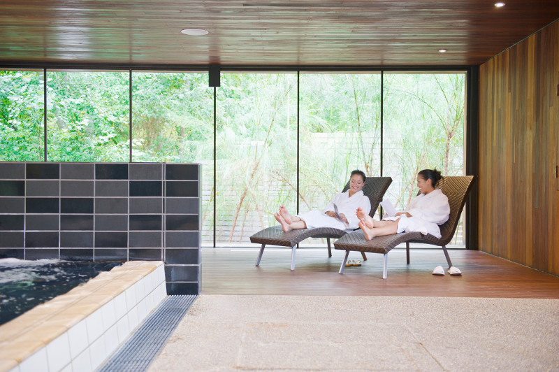 Two women relax in a spa in Daylesford, Victoria.
