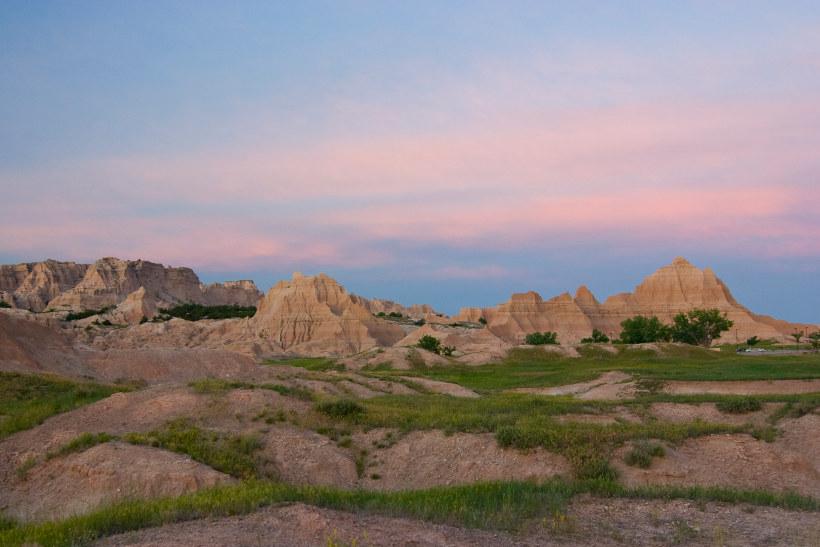 pink hued rock formations badlands national park south dakota