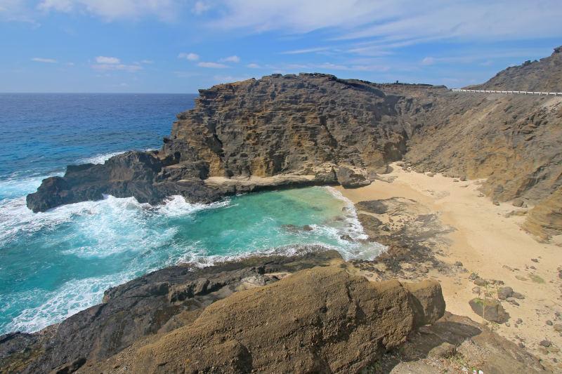 small beach between rocky outcrops