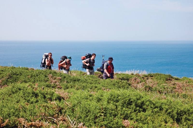 Walkers in the sun on the Pembrokeshire Coast Path.