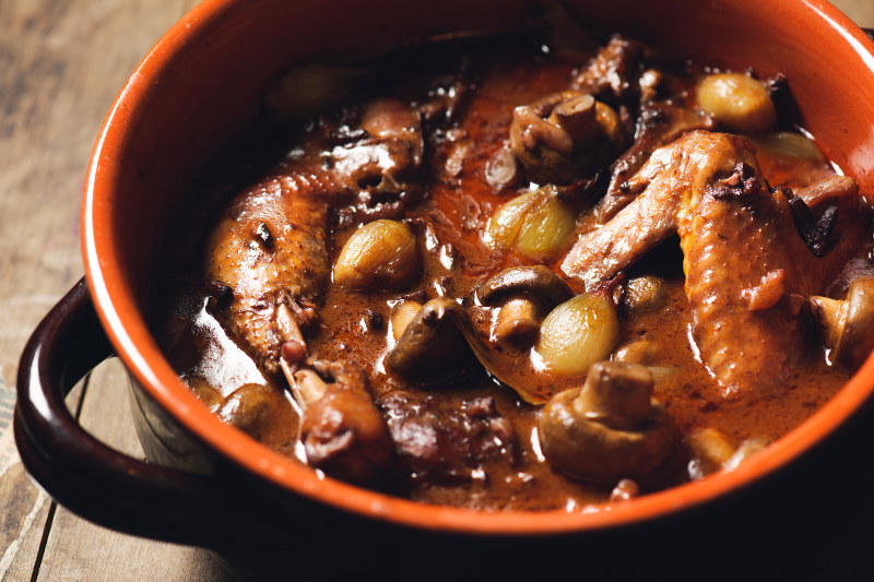 Coq au vin, chicken stew in bowl