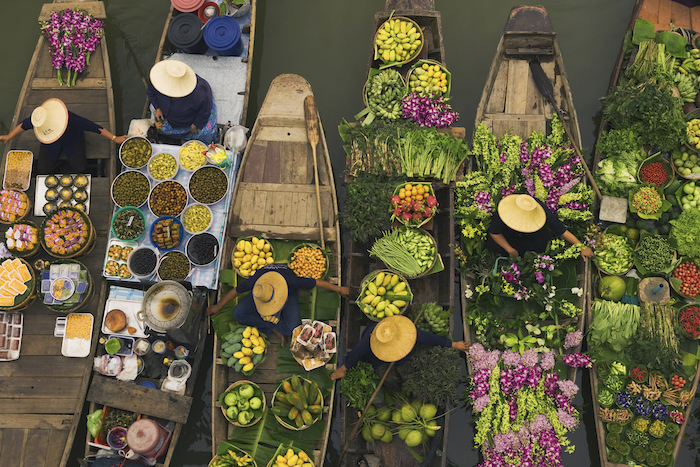 boats laden with fresh produce in Thailand - floating market