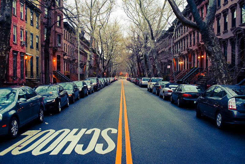Brooklyn street with cars parked, early morning.