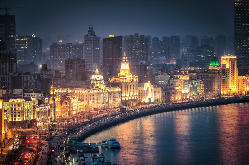 Night scene of the vibrant Bund promenade, Shanghai, China
