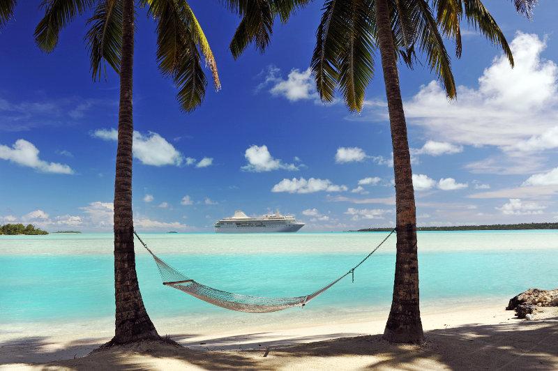 Ocean liner off shore of tropical island