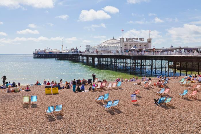 Brighton pier and beach on a sunny day, UK