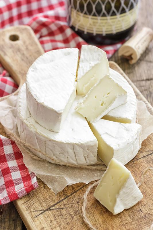 cut camembert cheese piled