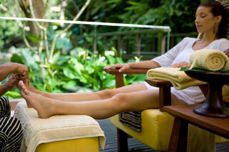 Woman receives a foot massage in a Bali villa