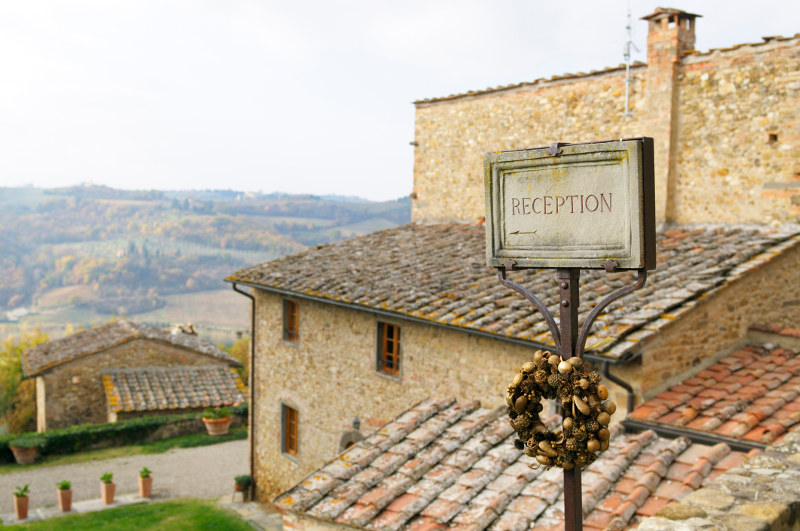 guest house sign in european countryside