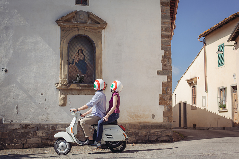 Couple on scooter in Italy