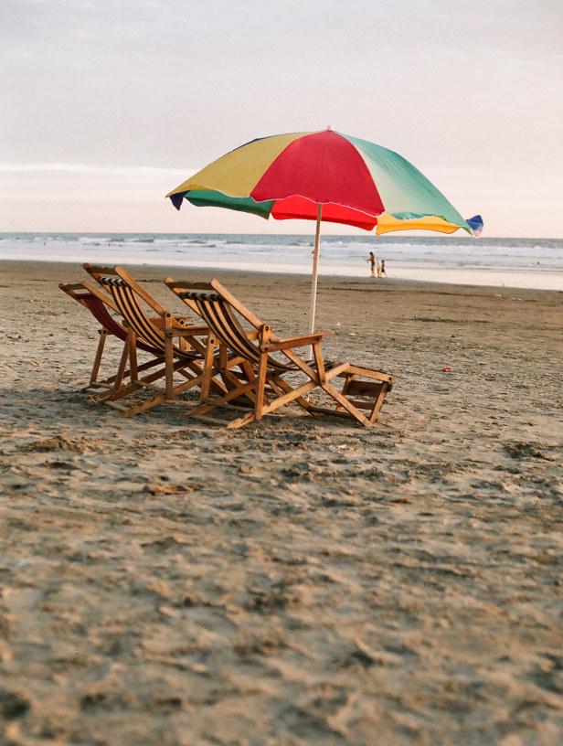 beach chairs on beach in ecuador