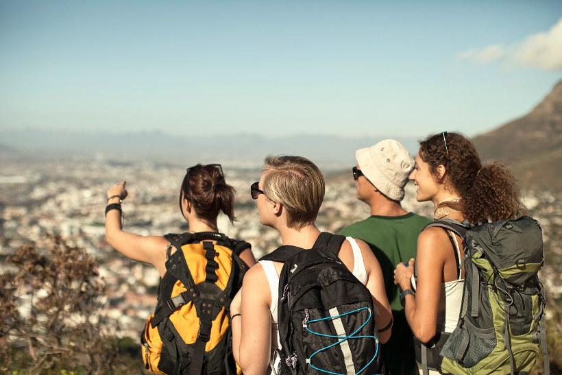 group on mountain overlooking city