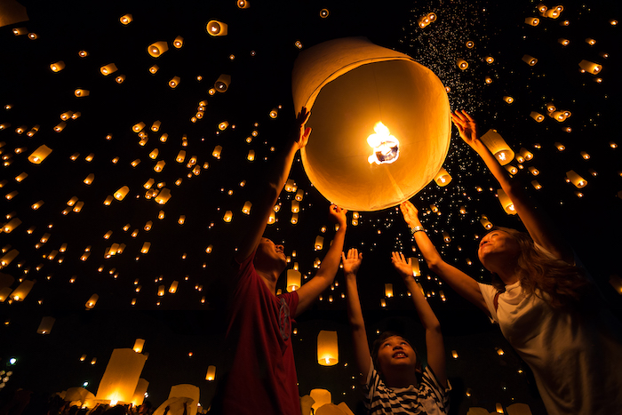 family release lanterns at Yi Ping festival - travel with kids in Thailand