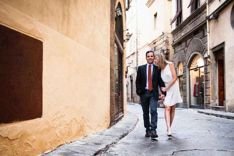 couple dressed up walking in italian street