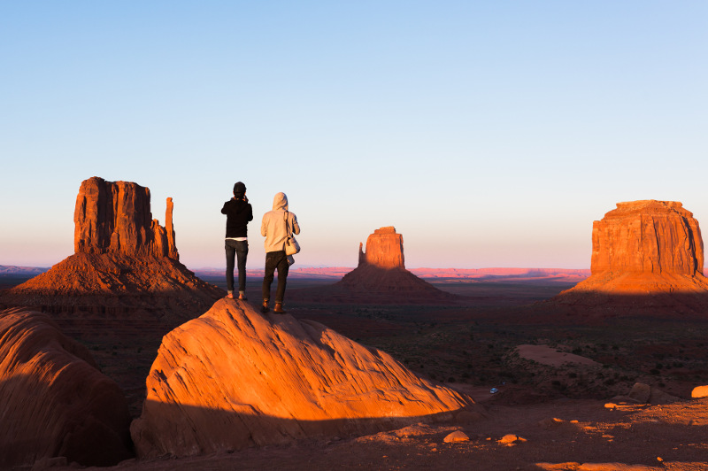 Two men looking at view of Monument Valley