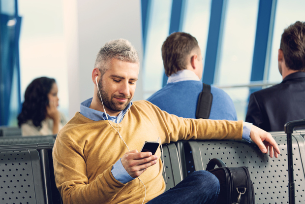 Man listens to music at airport