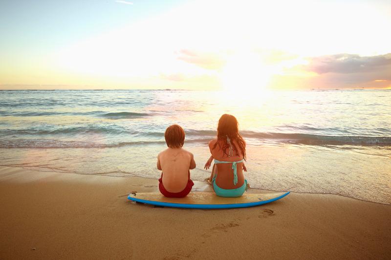 Two kids on beach in Hawaii