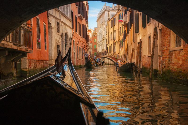 gondola under bridge in Venice, Italy