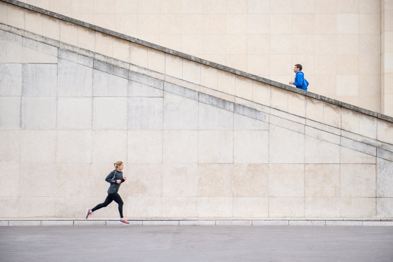 runners running up staircase