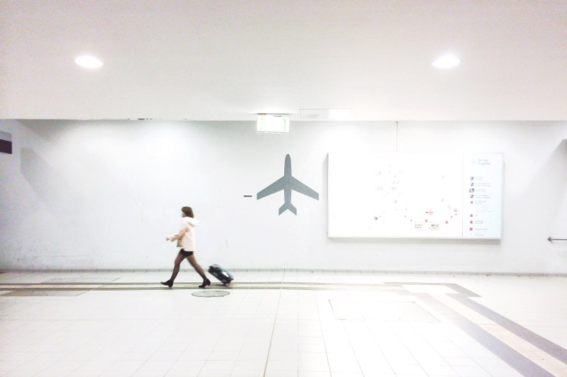 person walking through airport