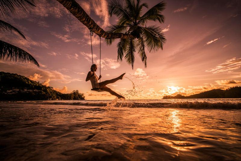 girl on swing over water