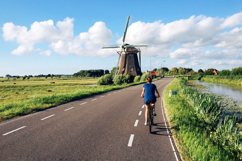 woman cycling on dutch road