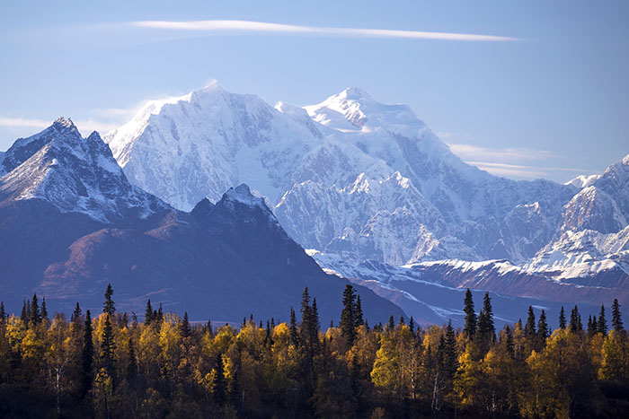 The distinctive peaks of Denali National Park in Alaska rise dramatically from the plains.