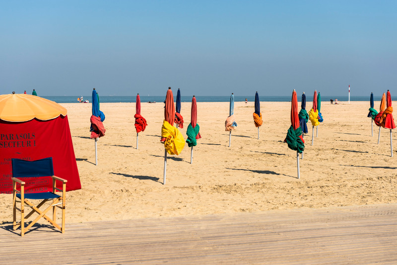 Colourful beach umbrellas at Deauville on the Normandy coast
