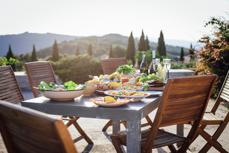 Table set for outdoor meal in Tuscany Italy