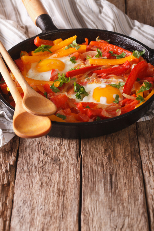 basque dish piperade with egg, capsicum in baking dish