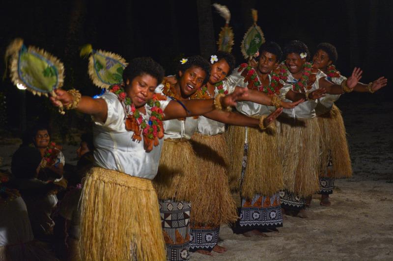 Fijian women performing the traditional Meke fan dance.