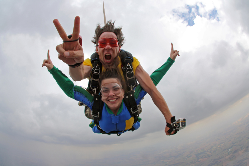 Couple tandem sky diving